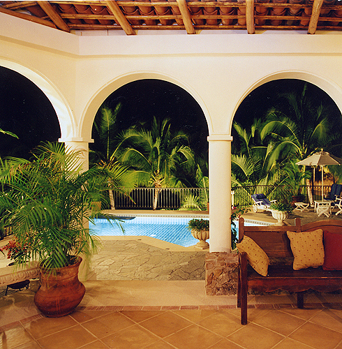 Relax poolside under the Palapa