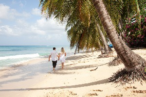 Couple Strolling along beach in Caribbean